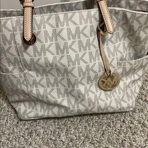 White and Tan Michael Kors purse